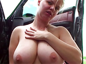 Cutie loves giving her horny boyfriend a boobjob in the car