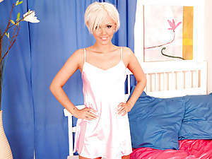 Blonde Nubile shows off her body in a seductive pink chemise