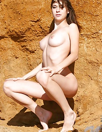 Naked nansy posing off the seafront and take a peek in her long slender legs