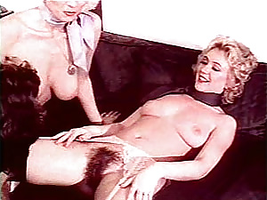 Two hairy seventies ladies inspecting a big cock