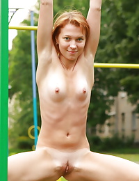 Playground queen tests all the equipment outside but forgets her clothes.