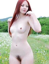 Lusty redhead uninhibited and seductive outdoors.