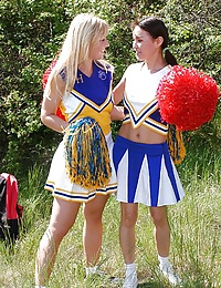 Two erotic cheerleaders licking their pussies outdoors
