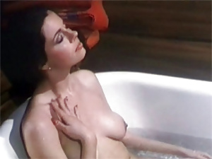 Hot retro babe playing with her wet pussy in the bathtub
