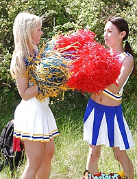Two heady cheerleaders licking and toying their snatches outdoors