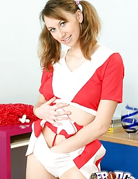 Comely cheerleader with pigtails strips and fingers her tight twat
