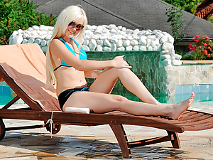 Petite Nubile cutie plays with her overheating pussy by the pool
