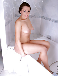 Teen Yudita gets wet and spreads her legs to reveal her dripping wet pussy in her bathroom