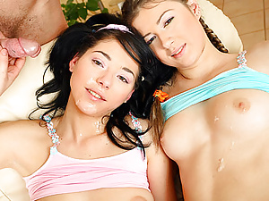 Two brunette teenagers enjoying a big load of thick semen