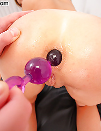 Tight assed teen takes anal beads