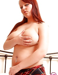 Hot redhead with massive titties shows her sexy naked body
