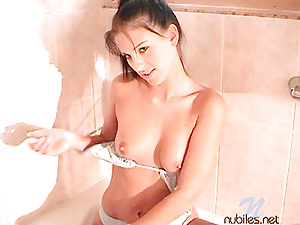 In the bathtub watch mili get naked and play with the water on her body