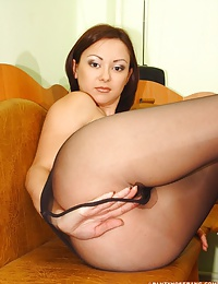 Brunette Elmira undressing and showing her black pantyhose