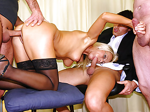 Slutty secretary is getting laid by three guys at the office