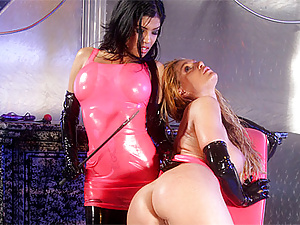 Beautiful lesbian ladies getting hot in femdom latex action