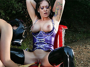 Kinky lesbian with gasmask spanks her sexy slave outdoors