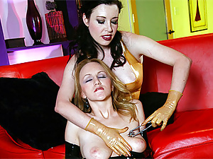 Very horny lesbian slave in a gasmask gets her clit rubbed