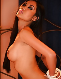 Very hot asian chick poses her body in the nude on her bed