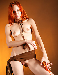 Artistic shoot inside with this pretty red head, with earthy colors.