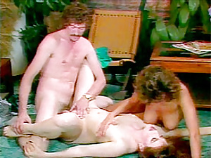 Two hairy seventies ladies sharing a stiff cock